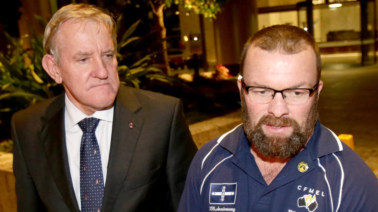 Ian Macfarlane from the Queensland Resources Council with Stephen Smyth from the CFMEU. Picture: AAP/Steve Pohlner