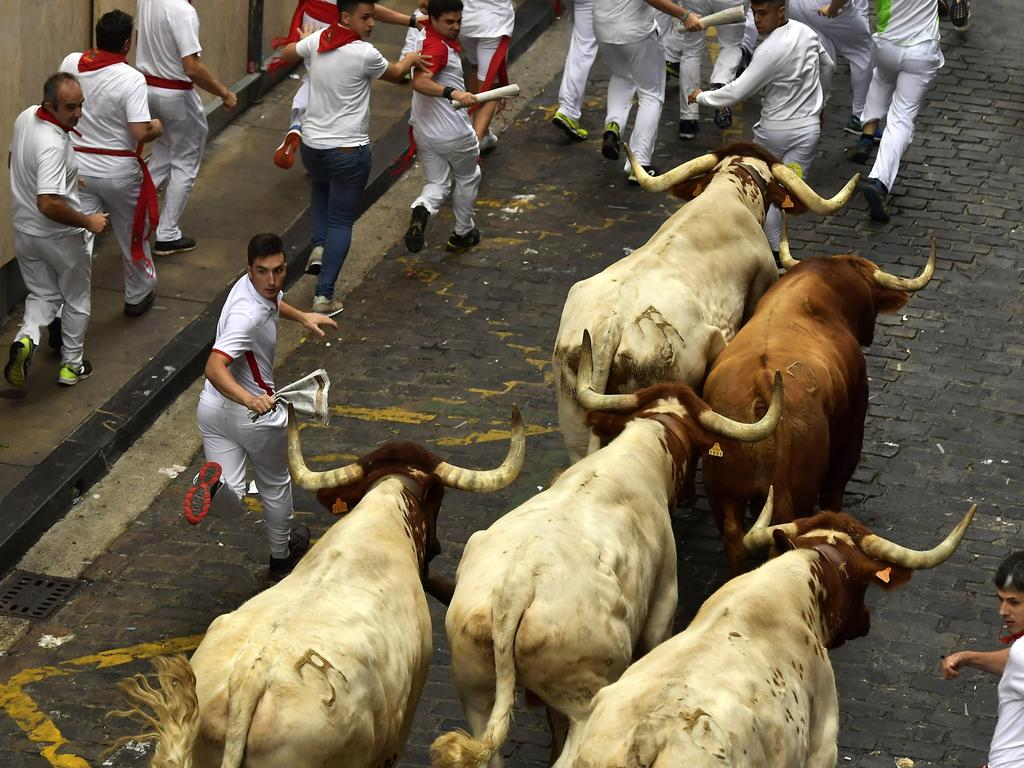People from around the world come to Pamplona every year to get chased by bulls. Picture: AP