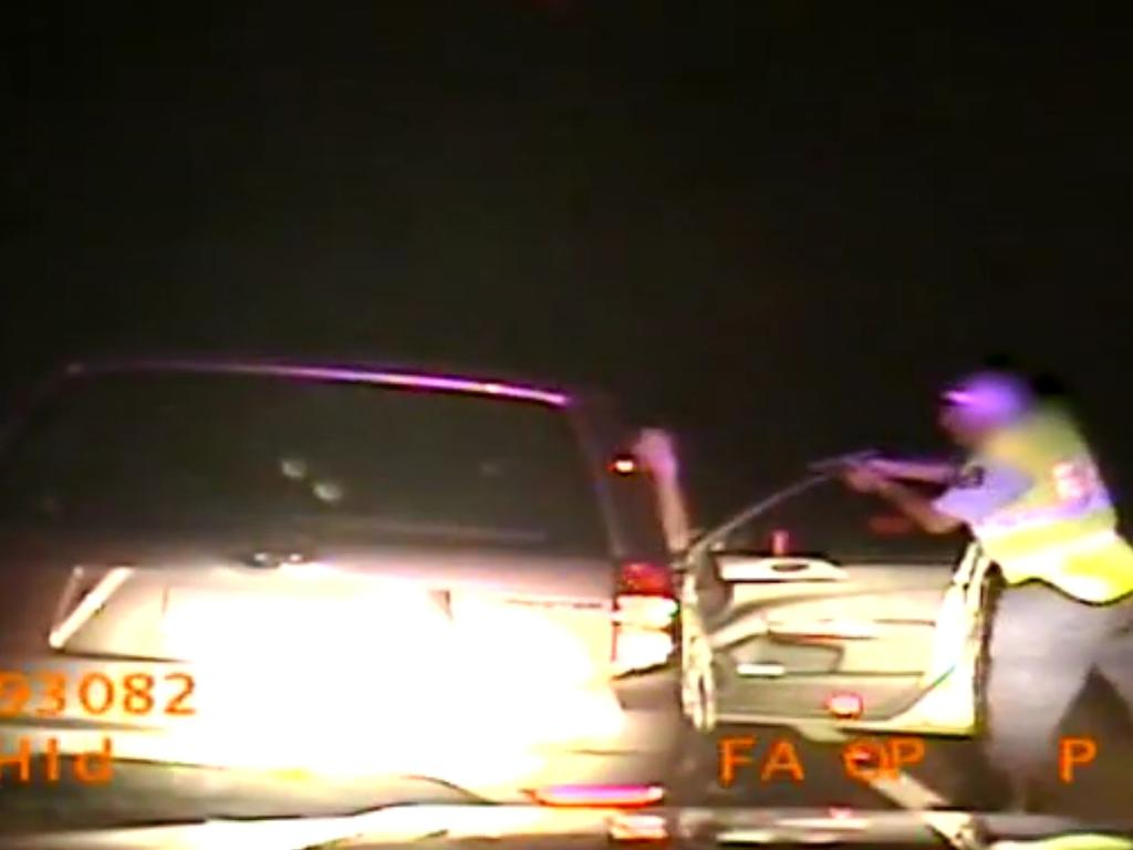 The officer pulls out his gun and points the firearm at his face during a random breath test stop. Picture: Supplied
