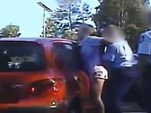 Cops slam woman's head on car during arrest