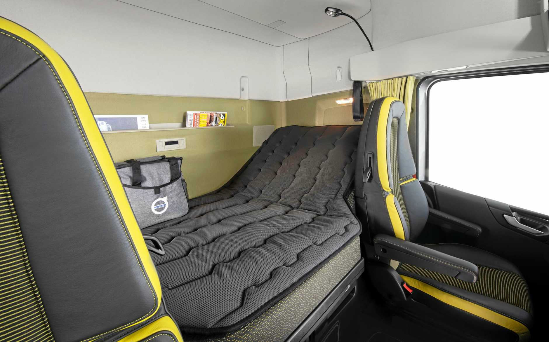 The wide soft bed has a recliner at the kerbside end. All controls are at hand.