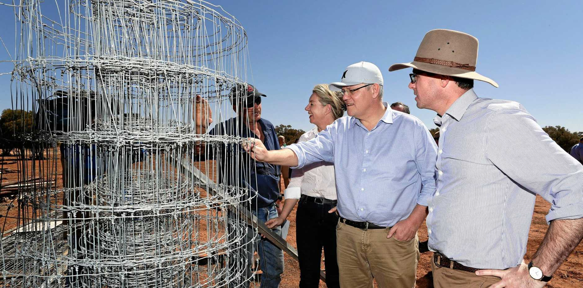 Sheep and cattle grazier Stephen Tully shows fencing material to Agricultural Minister Bridget McKenzie, Prime Minister Scott Morrison and Minister for Water Resources David Littleproud