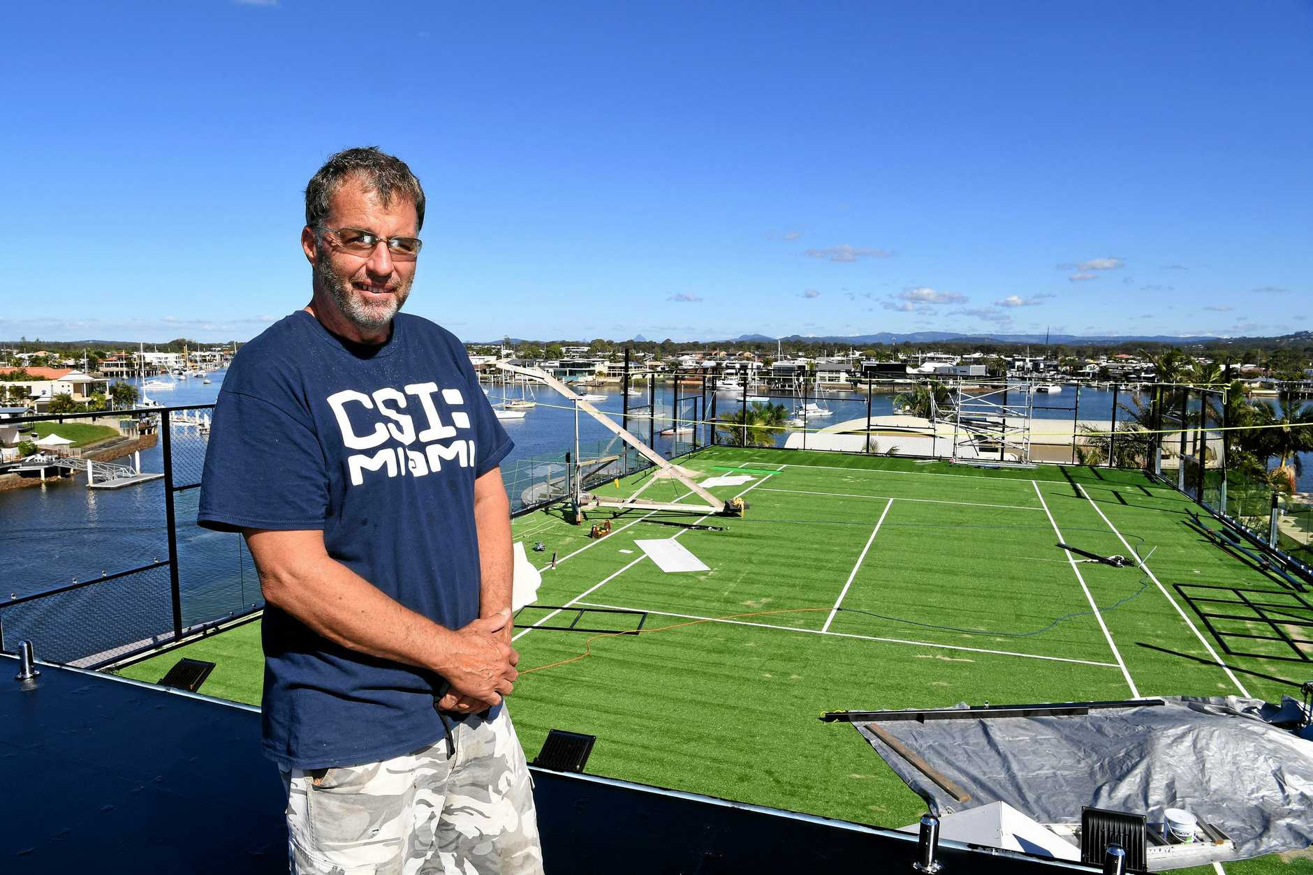 Wayne Dwyer says the fence on his Minyama Island home roof can be folded down to fit within height regulations.