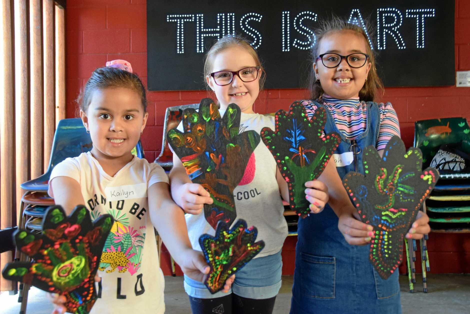 Kailyn Nixon, Ash Hengst and Jaidah Nixon at the NAIDOC week hand painting art workshop.