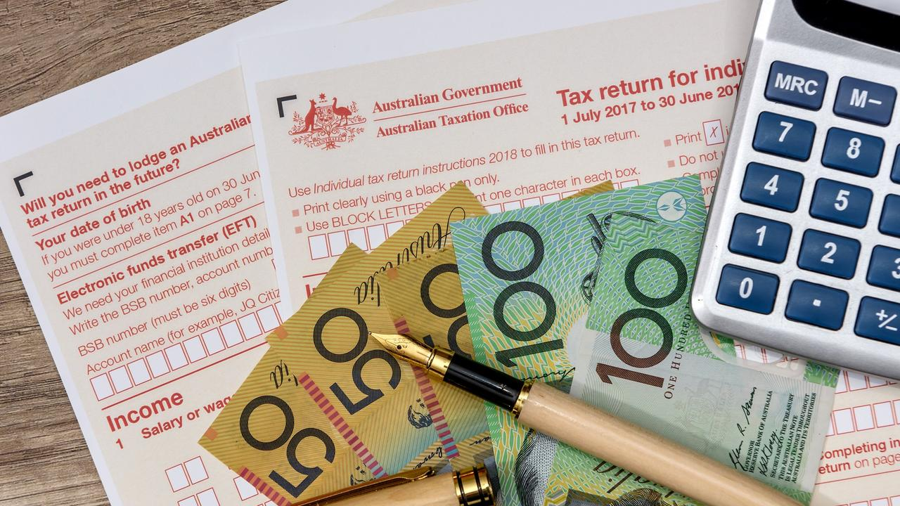 Australian dollars with calculator and tax form, tax time generic money, forms, taxation