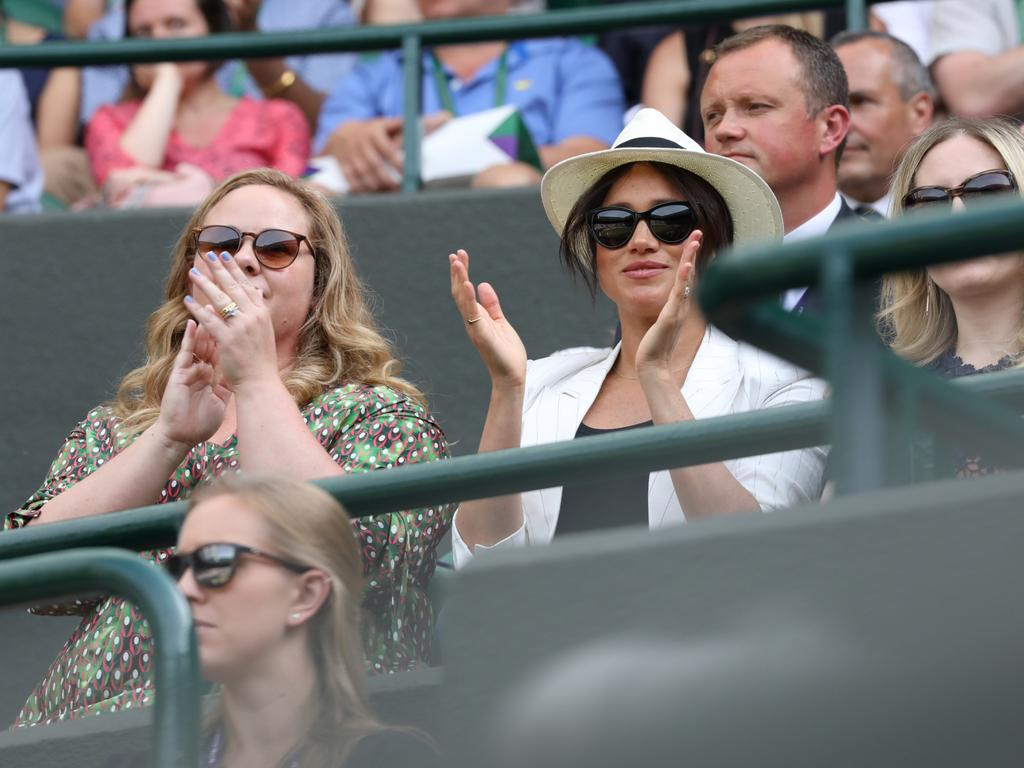 Megan Markle applauds the action between points. Picture: Ella Pellegrini