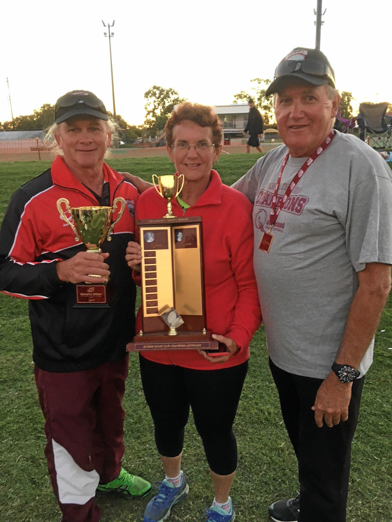 Rockhampton Junior Touch president Mick Callow, administrator Denise Edwards and Rockhampton Touch president Gary Benbow are all smiles after collecting the Champion Affiliate Cup at the 2018 Junior State Cup.