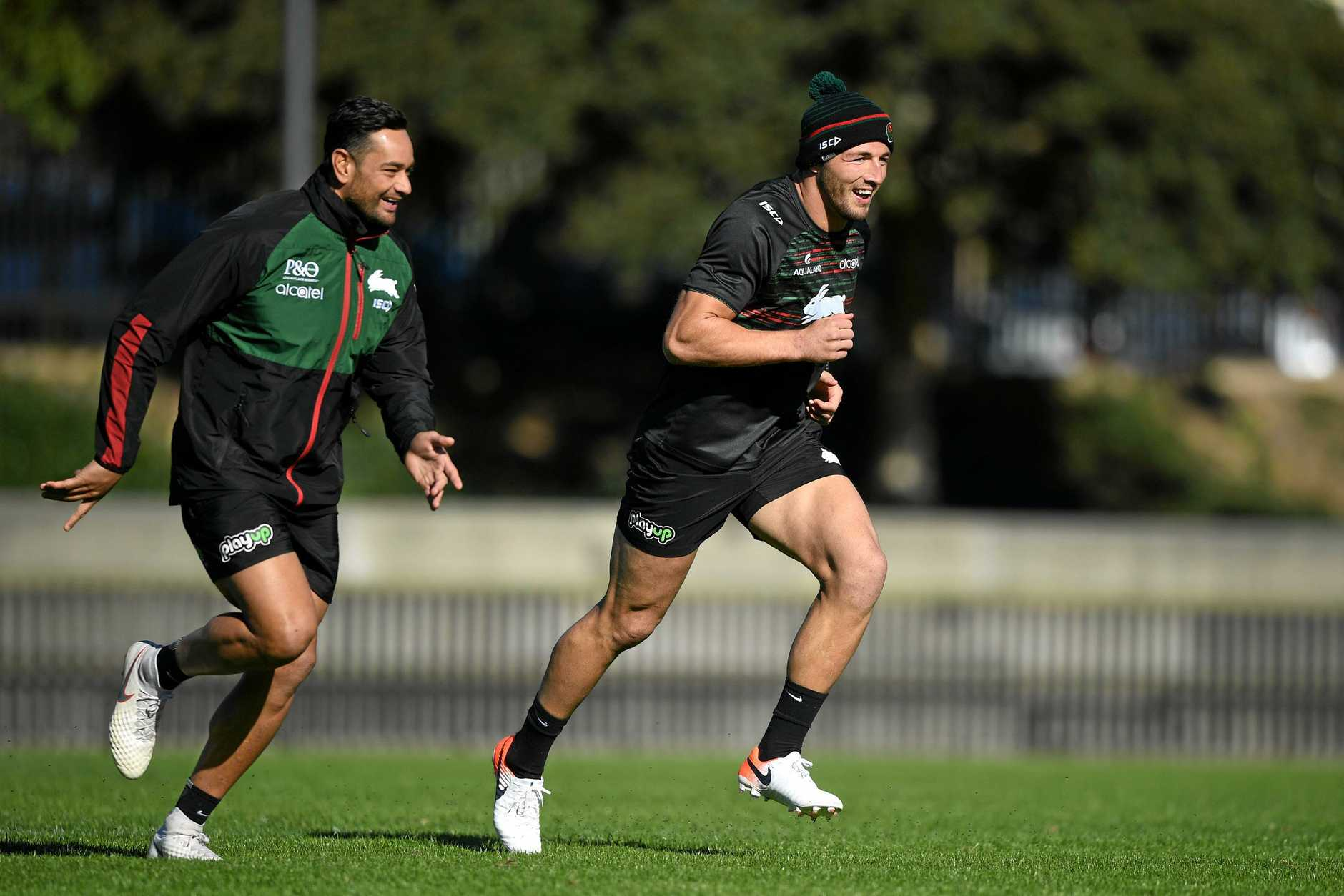 South Sydney Rabbitohs players John Sutton (left) and Sam Burgess are seen during a team training session at Redfern Oval in Sydney, Tuesday, May 28, 2019.  (AAP Image/Joel Carrett) NO ARCHIVING