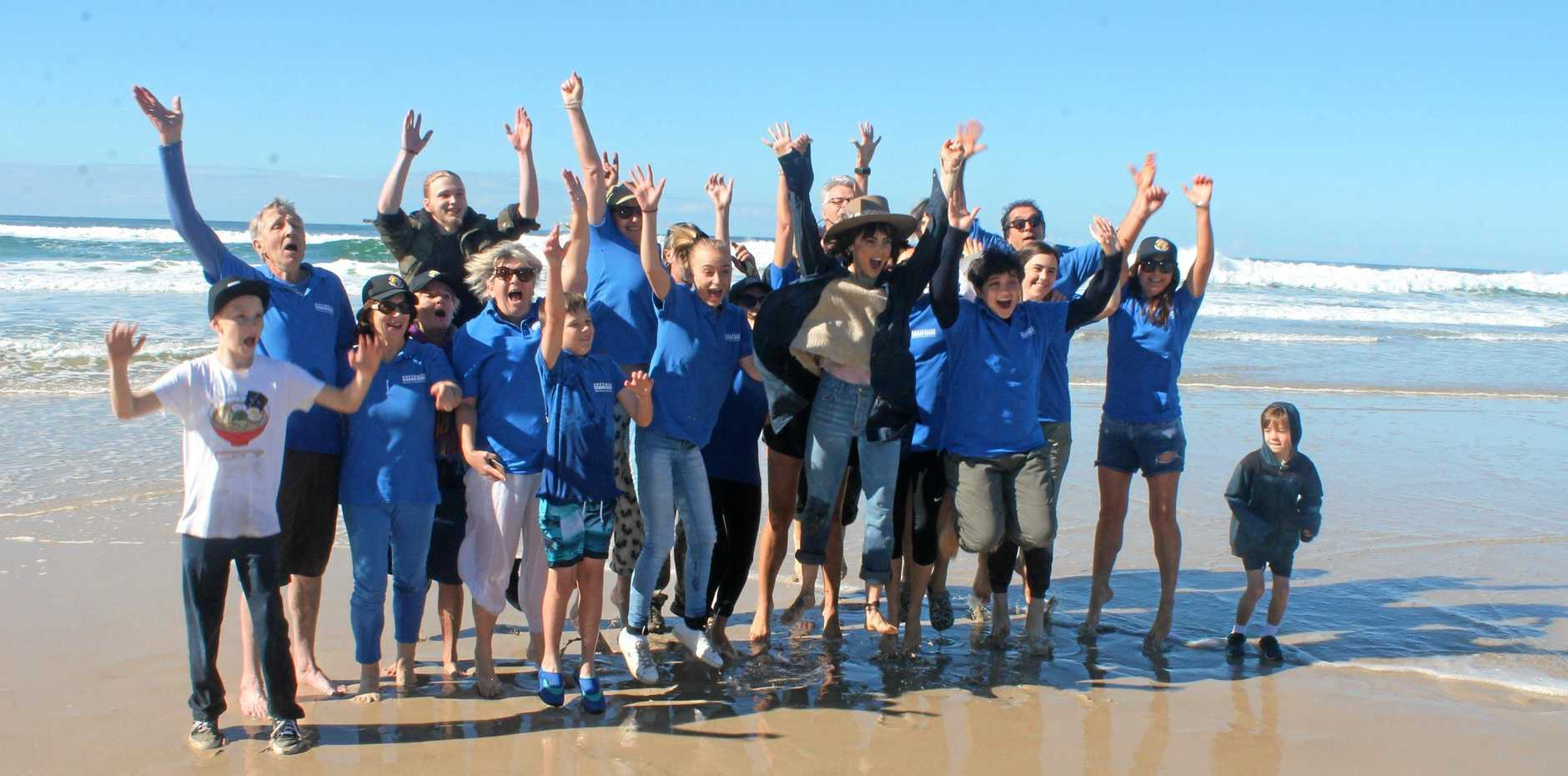 The Australian Seabird Rescue crew celebrate another successful turtle release at Ballina's Lighthouse Beach on July 10.