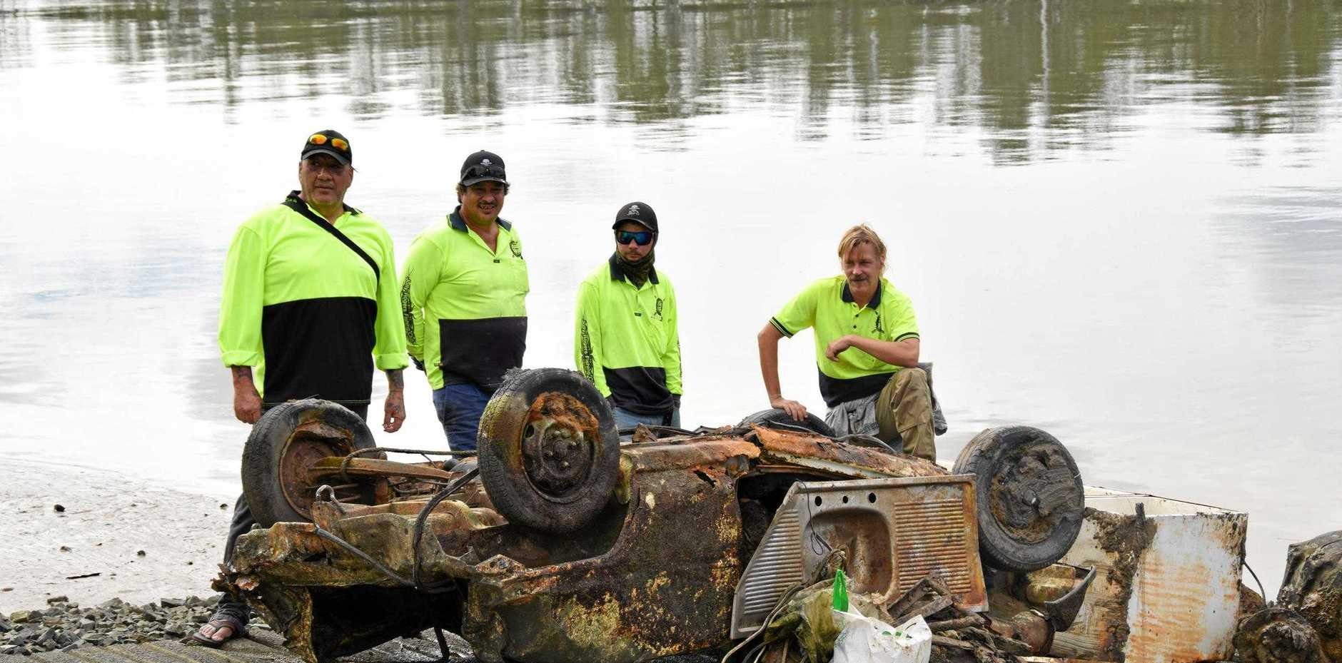 EVEN THE KITCHEN SINK: John Rakena, Neill XXavier, Bevin Harmsworth and Andrew Stecenko from Jolly Rogers Fishing Club display spent yesterday morning fishing for waste in the Fitzroy.