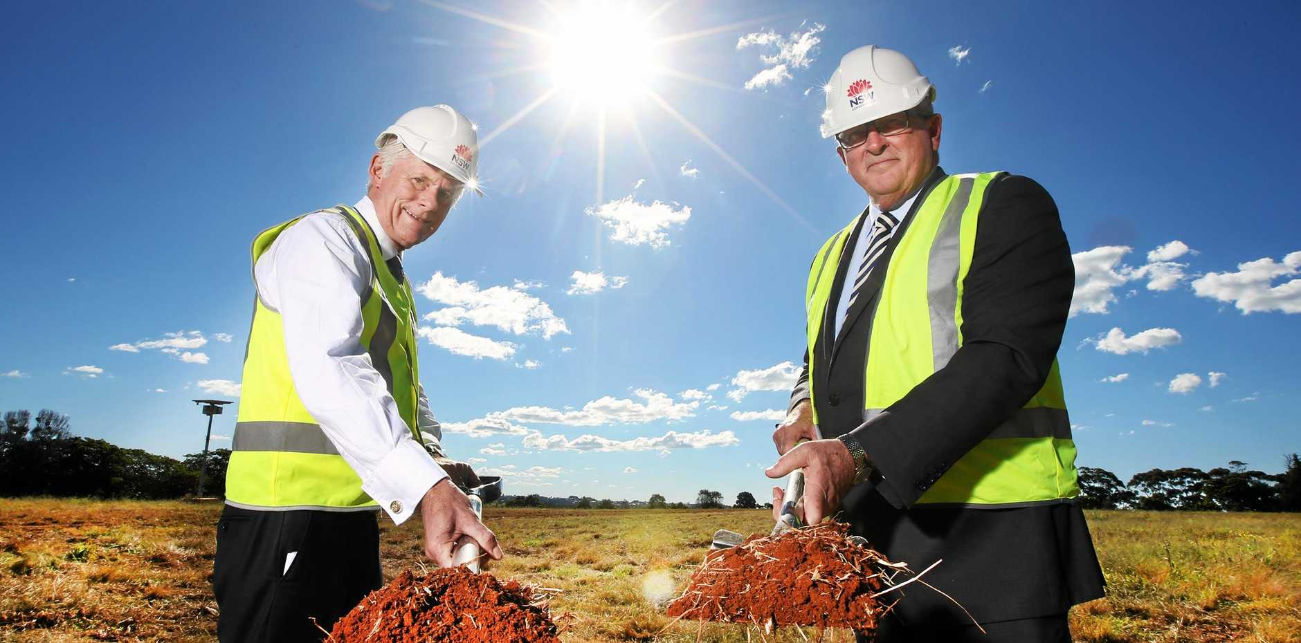 NSW Health Minister Brad Hazzard and Tweed MP Geoff Provest turn the first sod of dirt at the new Tweed Valley Hospital site.