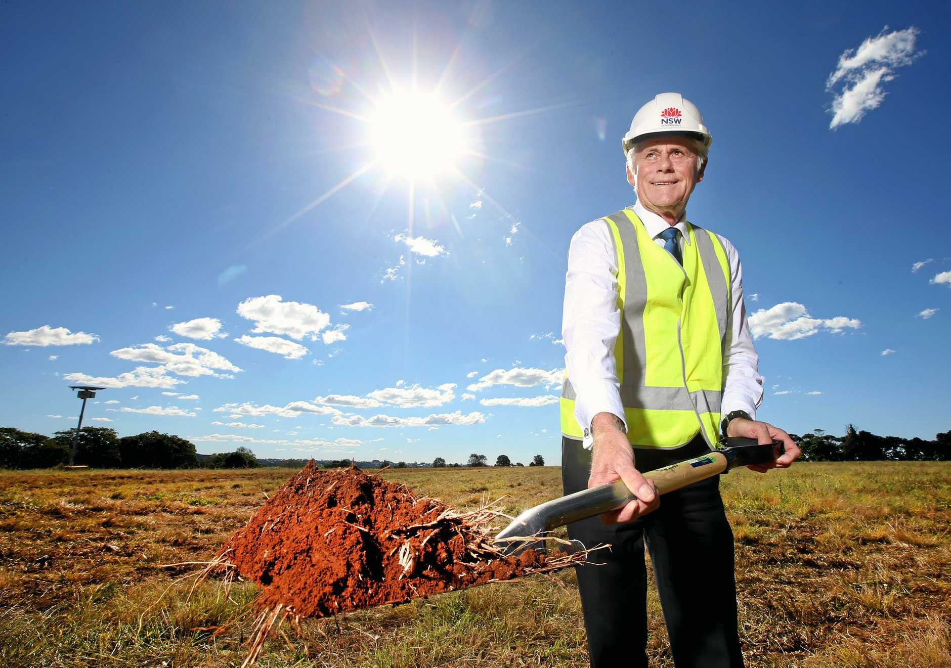 Tweed State Member Geoff Provest turns the first sods of dirt on the new Cudgen Hospital site.