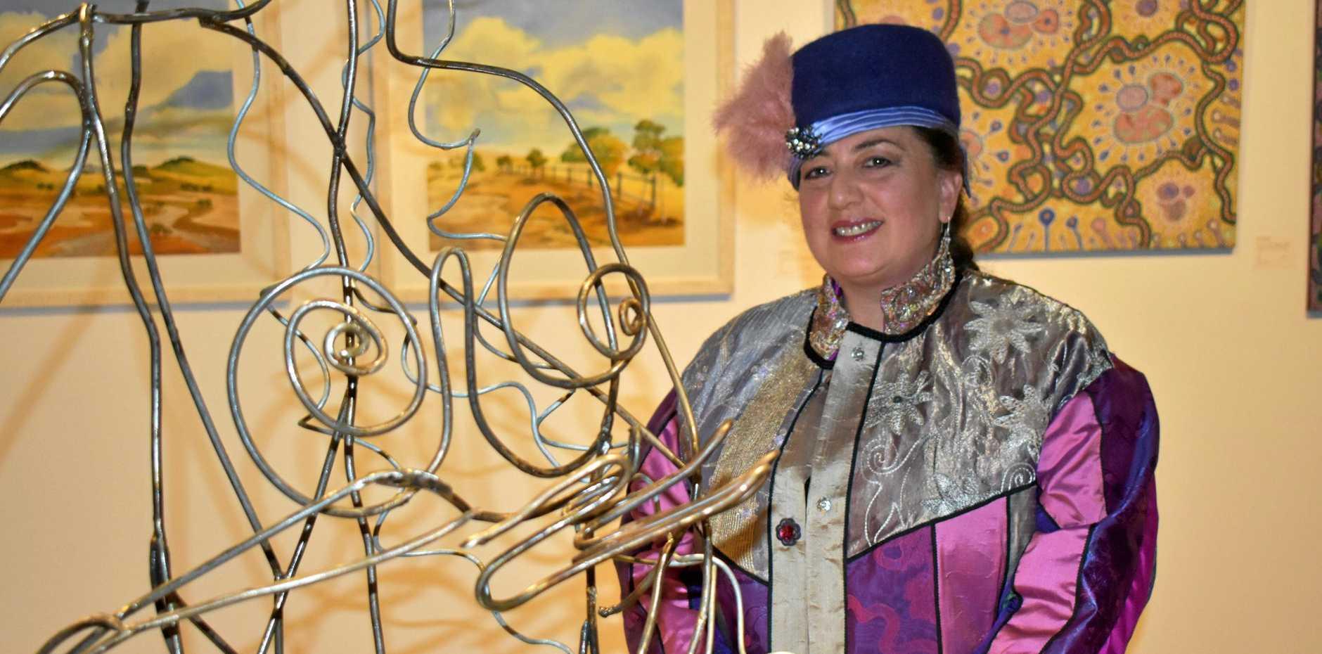 VIBRANT DESIGN: Fabric artist, Maria Mastro with her work.