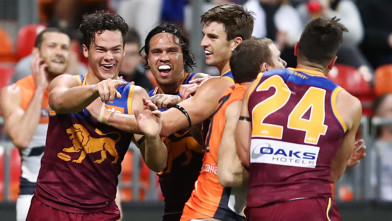 Rayner celebrates with teammates after kicking a vital goal in last week's boilover at GIANTS Stadium. Picture: AAP Image/Brendon Thorne