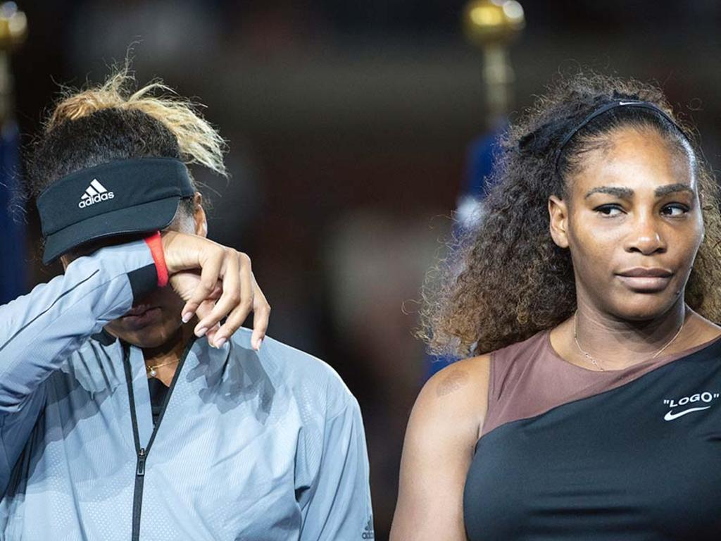 Naomi Osaka in tears alongside Serena Williams. (Photo by Tim Clayton/Corbis via Getty Images)