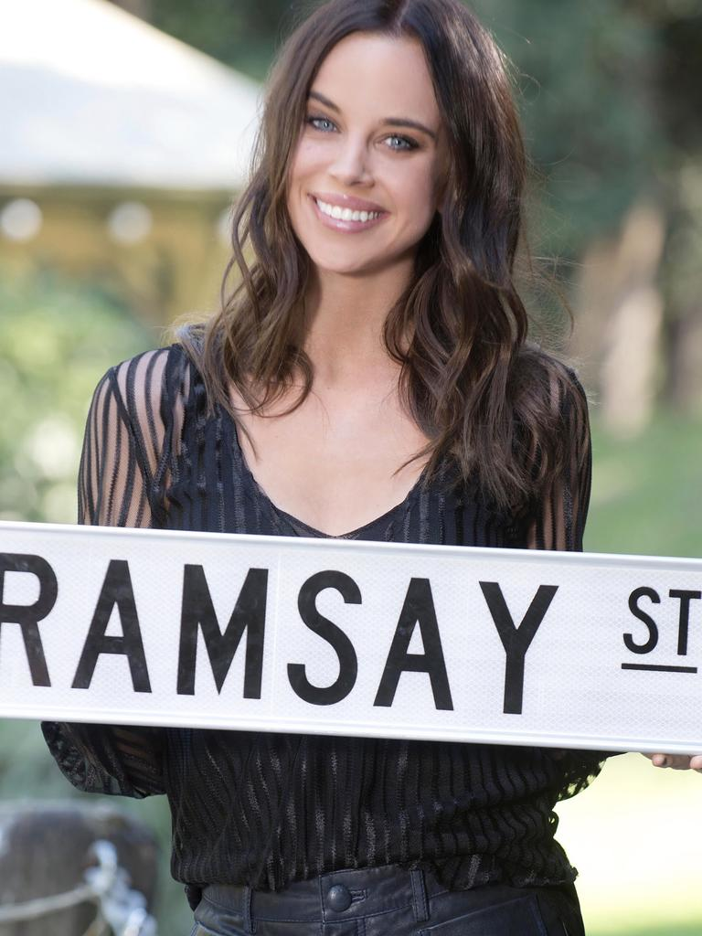 Bonnie Anderson with the Ramsay Street sign.