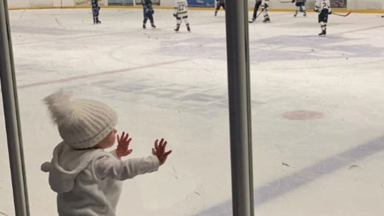 Chloe loved to watch her brothers play hockey through glass windows, which are similar to the panes on board the ship.