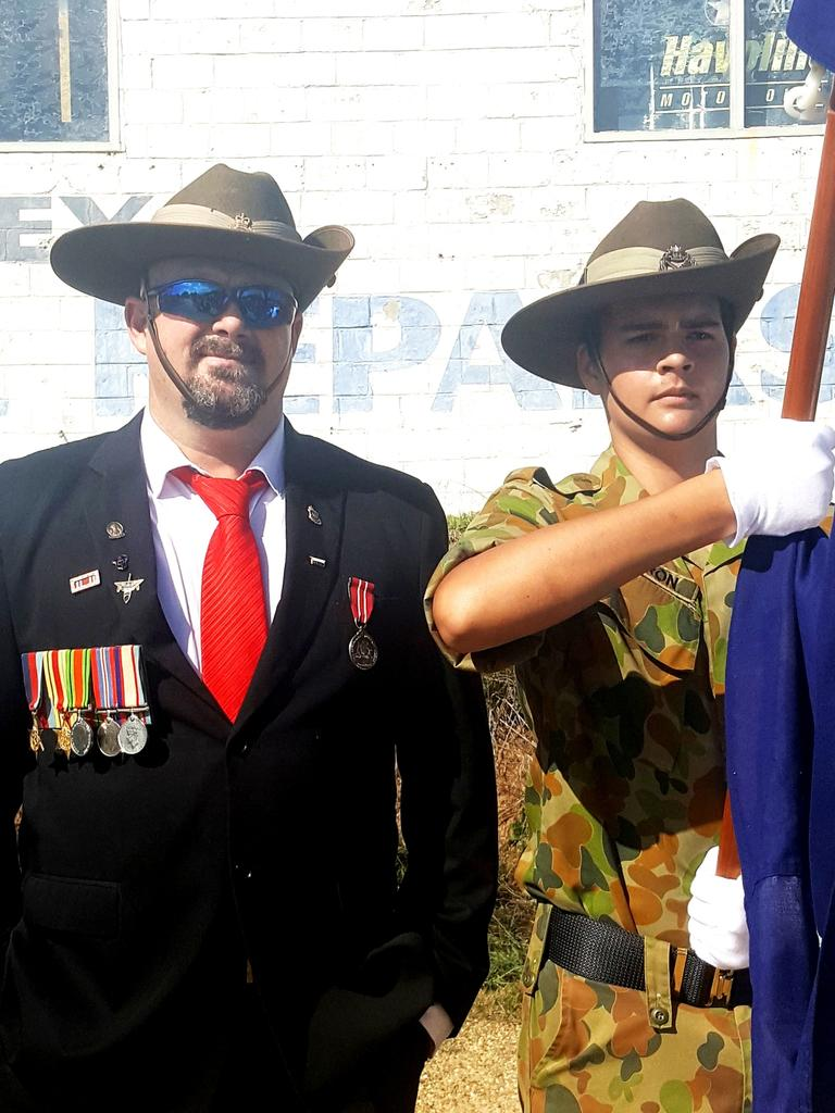Michael Cameron with his son Eli, 15, on Anzac Day this year.