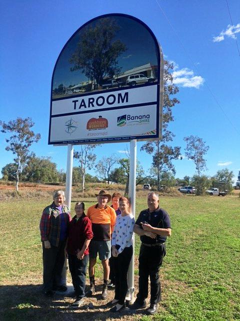 LOCALS: Taroom locals Anita Lethbridge, Greg Shearer, Glenys Shearer, Lucy Thornton, Micky Souvlis, and Sheree Adcock under the Taroom sign adjacent to the waste facility site.