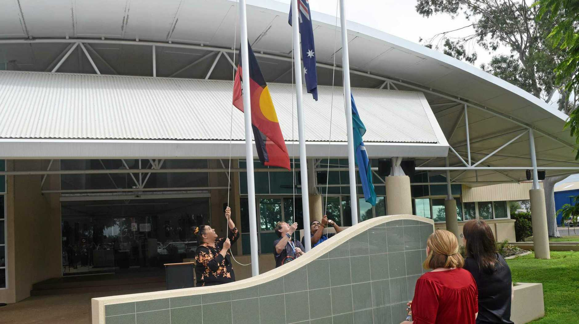NAIDOC CELEBRATION: The raising of the flags at the Department of Natural Resources, Mines and Energy's NAIDOC ceremony in Emerald.