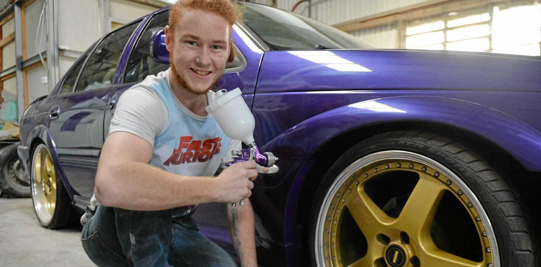 Fleet Image Mackay apprentice Aaron Surian, 18, with a purple EB GT mockup Ford. The Ford's purple paint is the 15th most popular shade for cars in the Mackay, Whitsunday and Isaac region.
