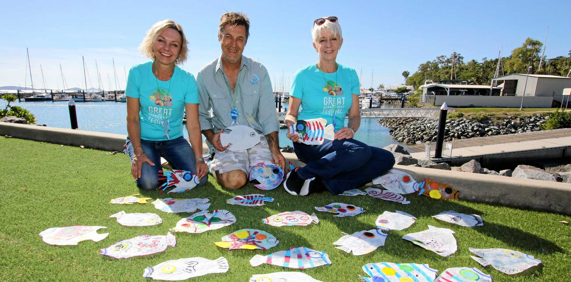 WORKSHOP: Margie Murphy and Anita Pender (left and right) from the Great Barrier Reef Festival with upcycling artist David Day.