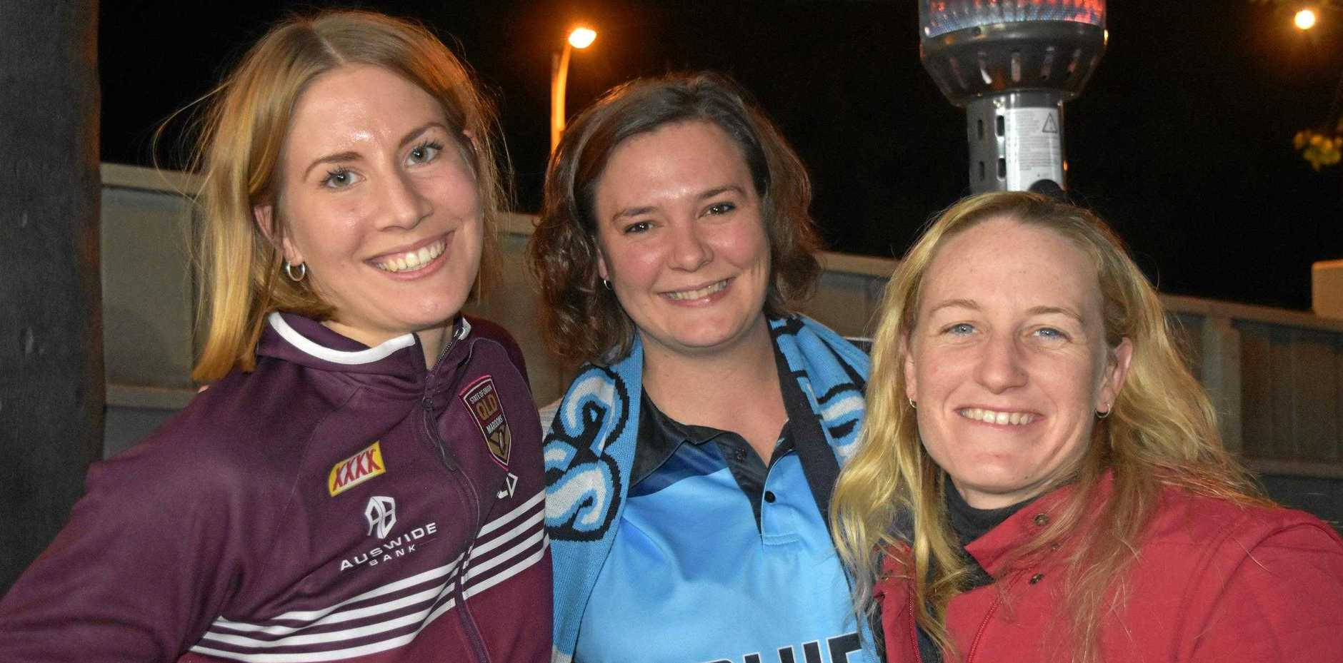 FRIENDLY BATTLE: Lidewij Koene, Theresa Hunter and Kat Oliver didn't let the tough competition come between them as they headed to the Criterion to watch Origin III.