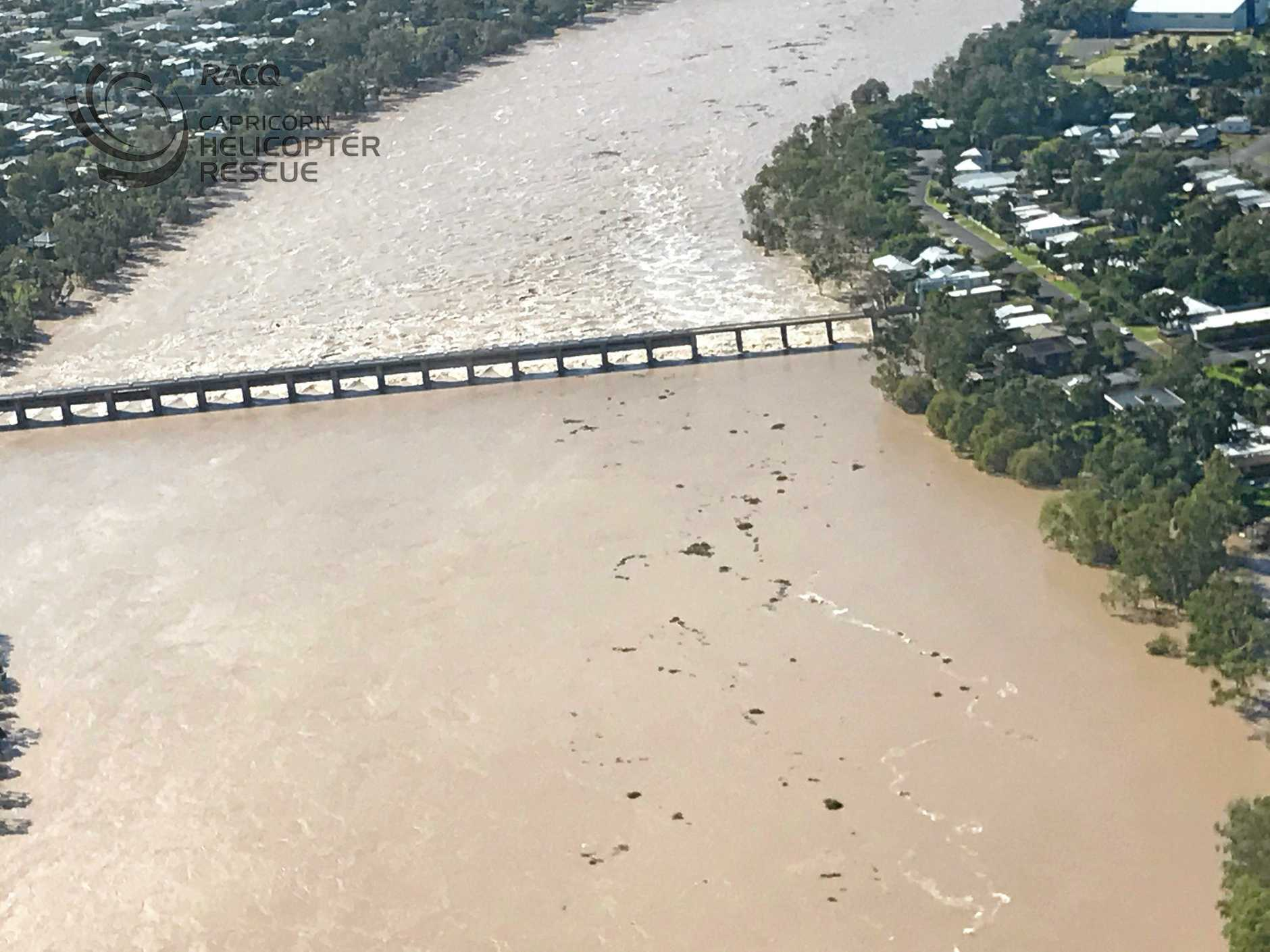Flood water flows through the Fitzroy River Barrage into Rockhampton.