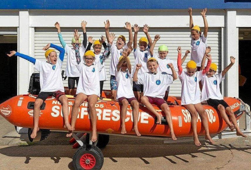 HERE TO STAY: Nippers having a ball at Peregian beach in their new uniforms.