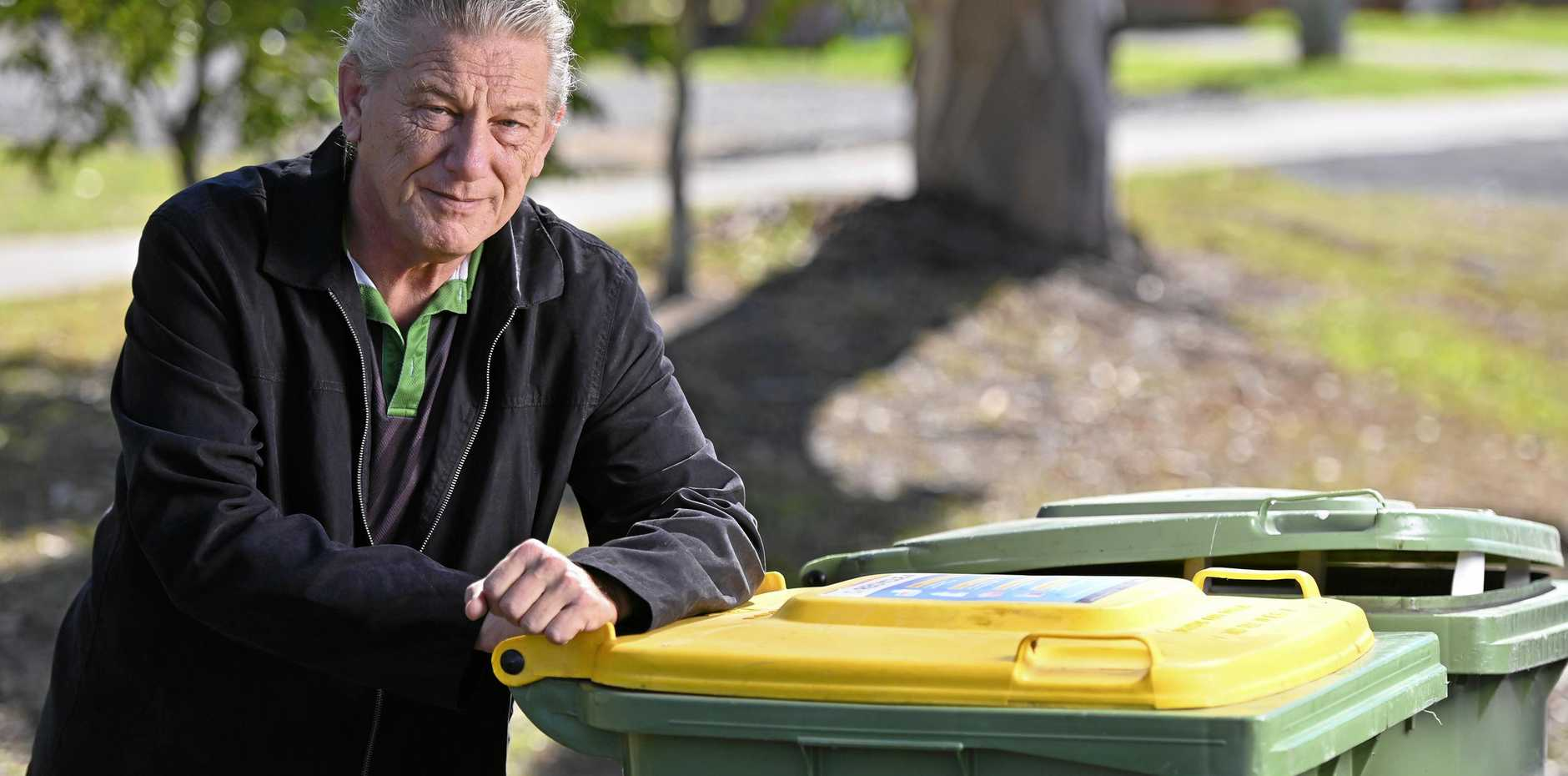 Description:Keith Owen has had a terrible time with the council, including being charged rates for his wheelie bins even though the house was inundated from the floods.