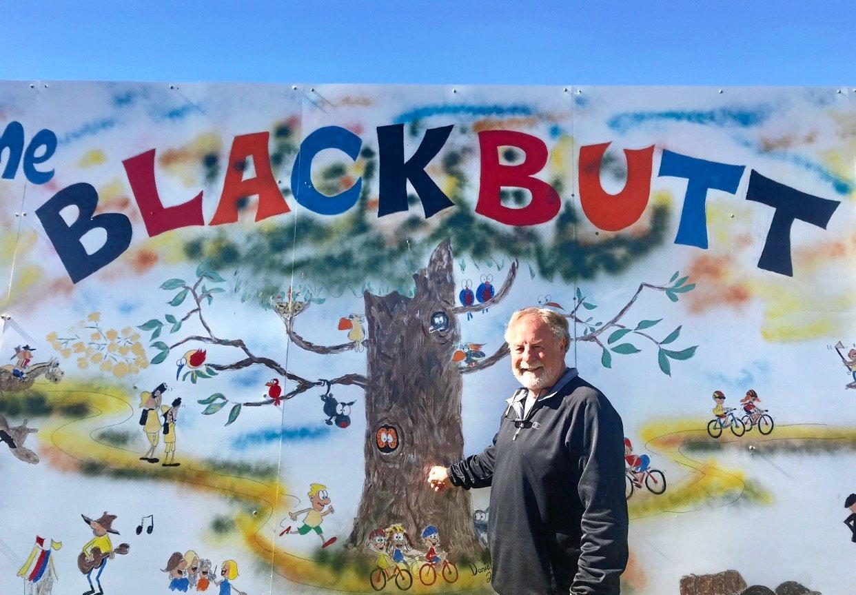 NEW MURAL: Blackbutt artist David Daniel with his new mural at the showgrounds.