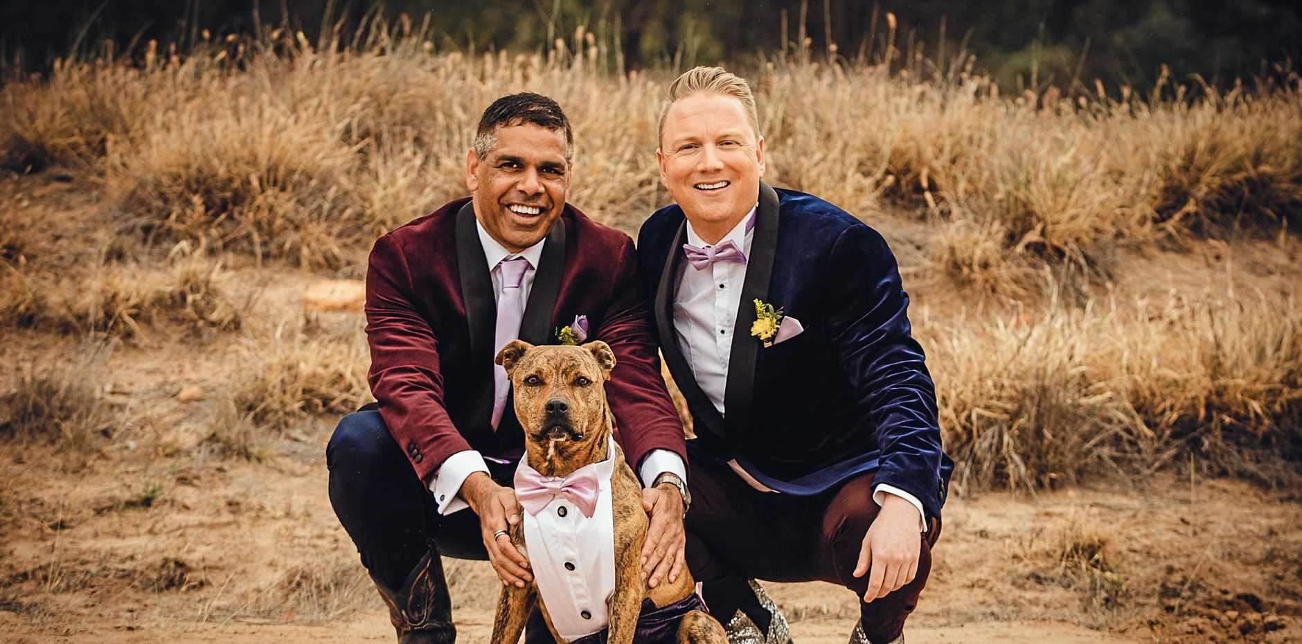LOVE IS LOVE: Malcome Mitchell and husband Ian McDonald with their dog, Kronk, at their wedding in Mitchell on Saturday.