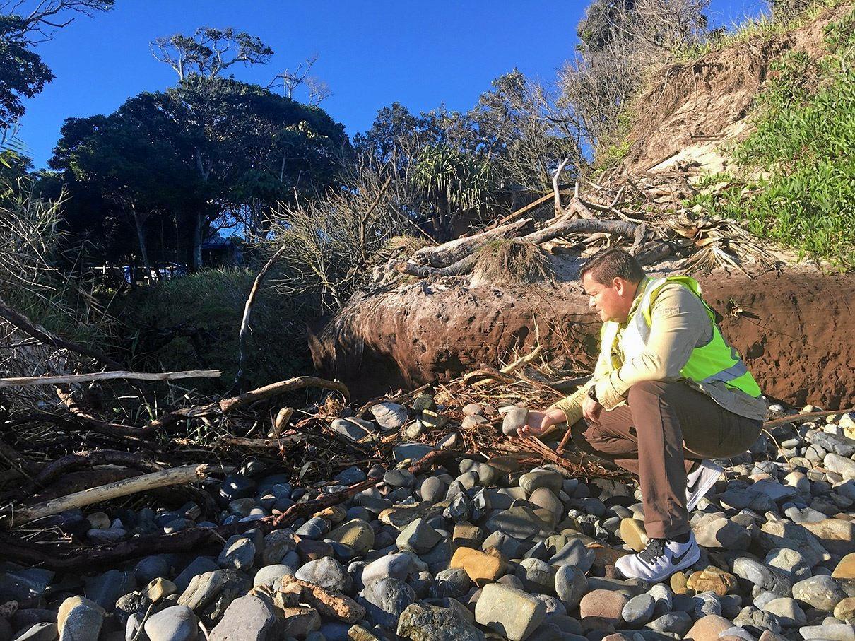DAMAGE: Group Manager of Operations Steve Bennett inspecting the debris on Clarkes Beach.