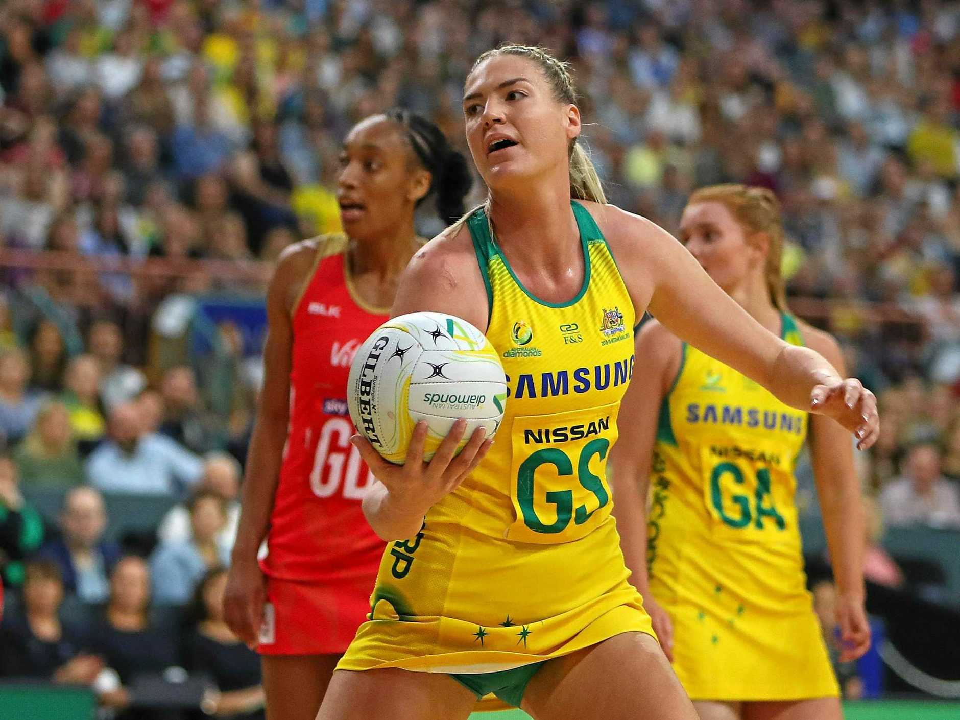 NEWCASTLE, AUSTRALIA - SEPTEMBER 19:  Caitlin Bassett of the Diamonds controls the ball during the Quad Series International Netball test match between the Australian Diamonds and the England Roses at Newcastle Entertainment Centre on September 19, 2018 in Newcastle, Australia.  (Photo by Tony Feder/Getty Images)