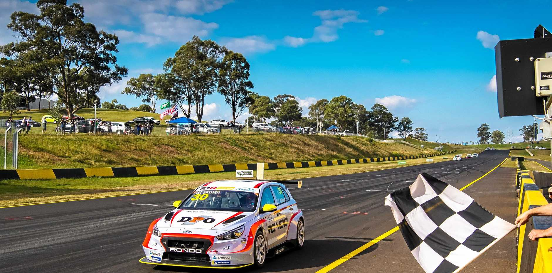 IN FRONT: Toowoomba's Will Brown crosses the line first to secure a round 1 TCR Australia race win at Sydney Motorsport Park.