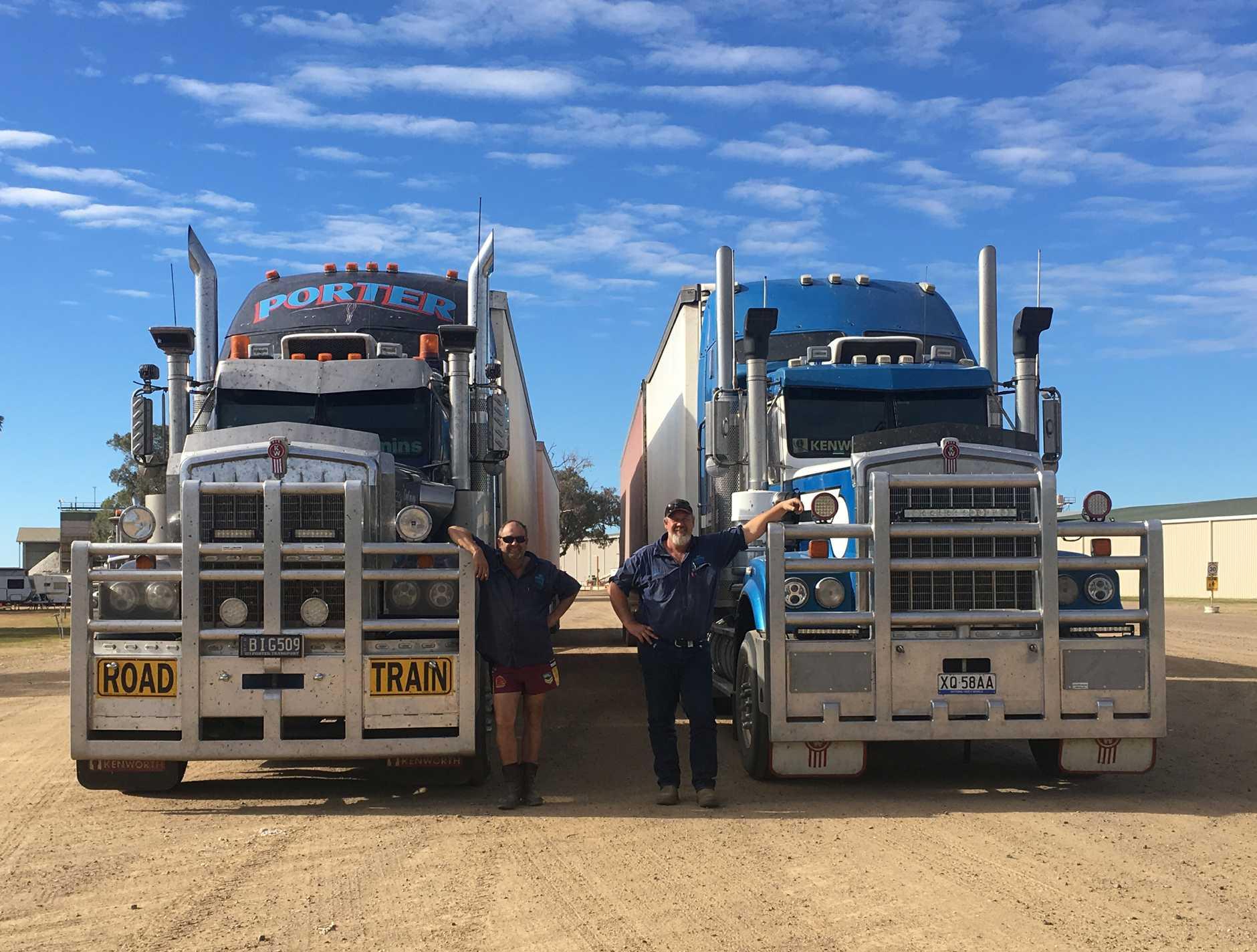Troy Baillie and Derek Porter next to their trucks. DD Porter Transport is closing down next week.