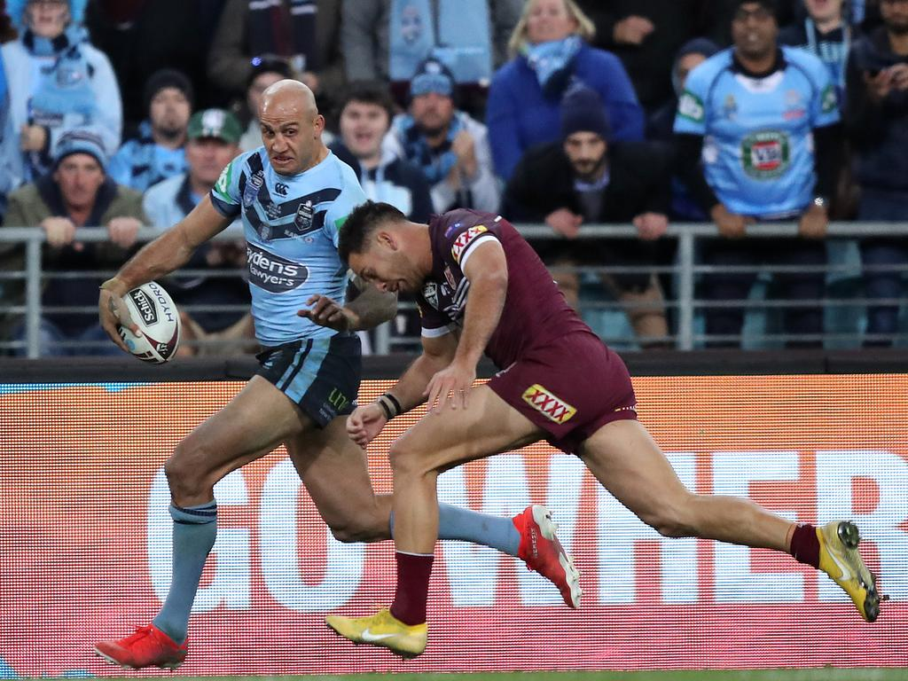 Blake Ferguson just stays in to set up the winning try for James Tedesco. Picture: Brett Costello
