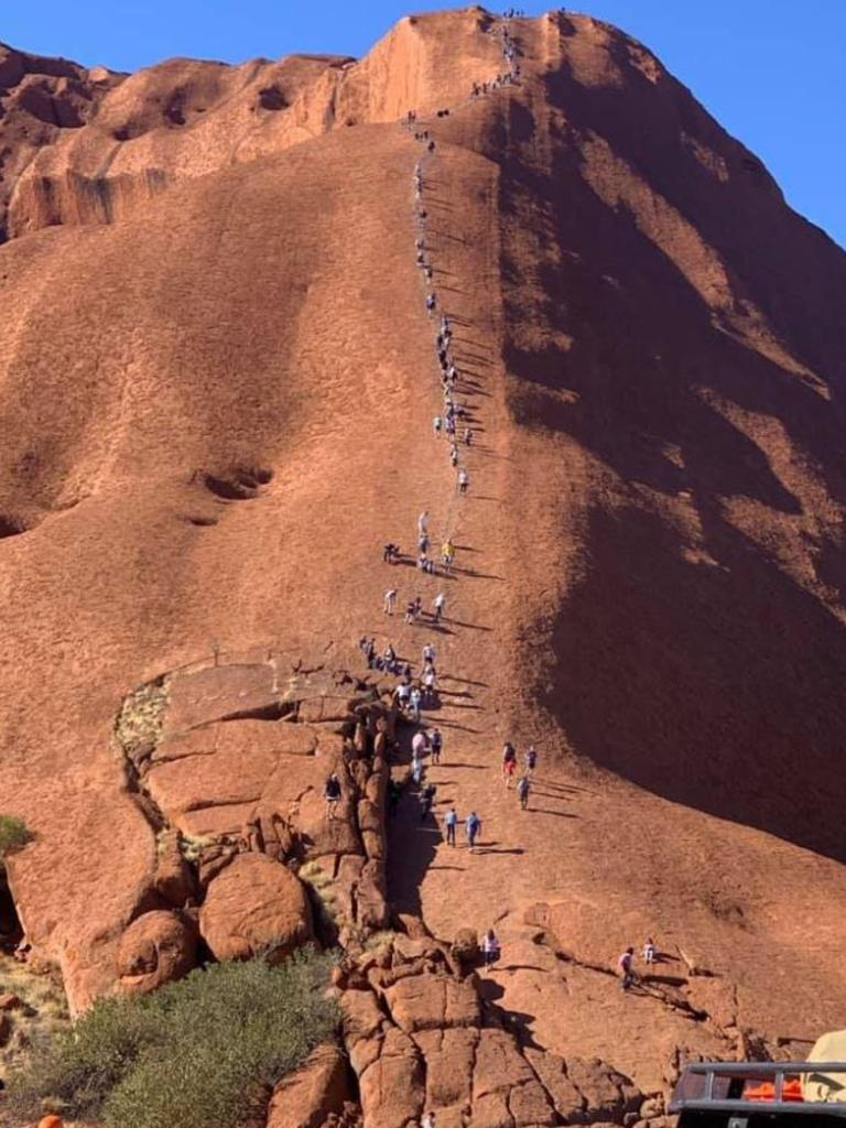 A photo of tourists climbing Uluru has left traditional landowners furious. Picture: ABC