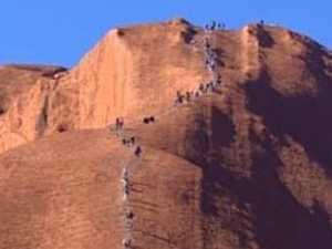 Anger as tourists swarm Uluru before climb closes