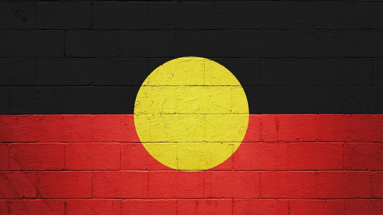 Channel 9's Brooke Boney and Karl Stefanovic have dared a company blocking the use of the Aboriginal flag in footy to sue them.