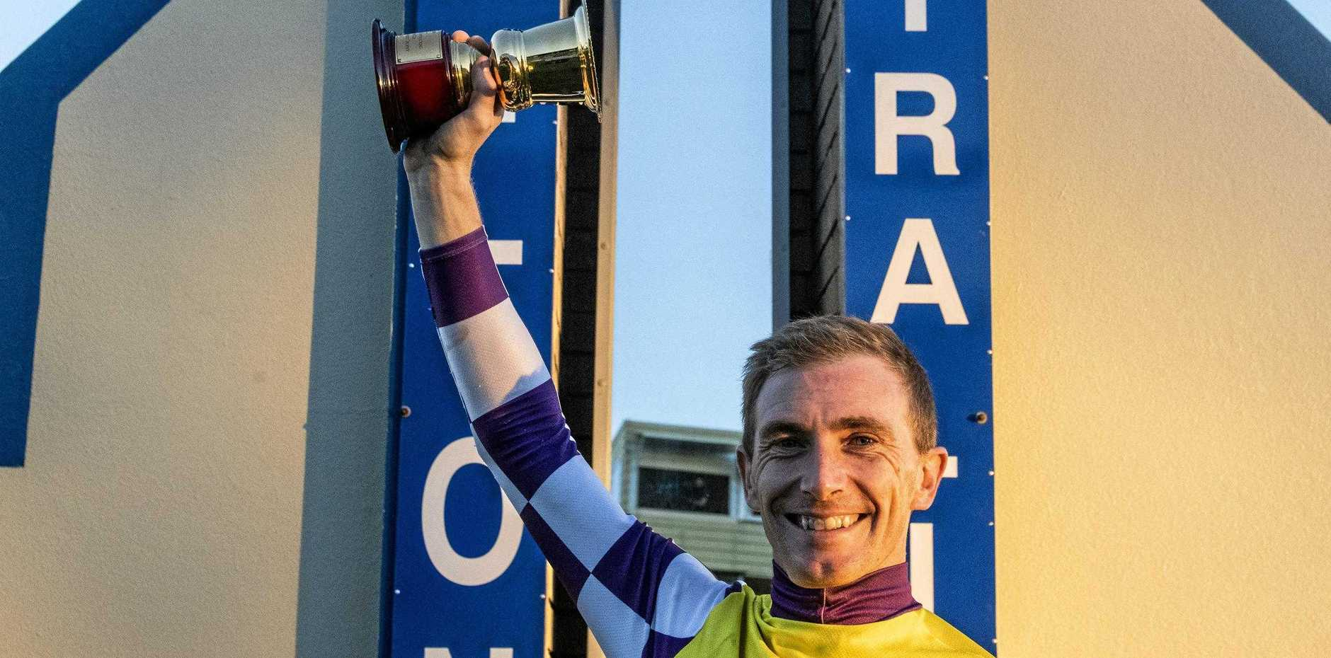 Ben Looker celebrates winning the 2019 Grafton Cup aboard Sacred Day.