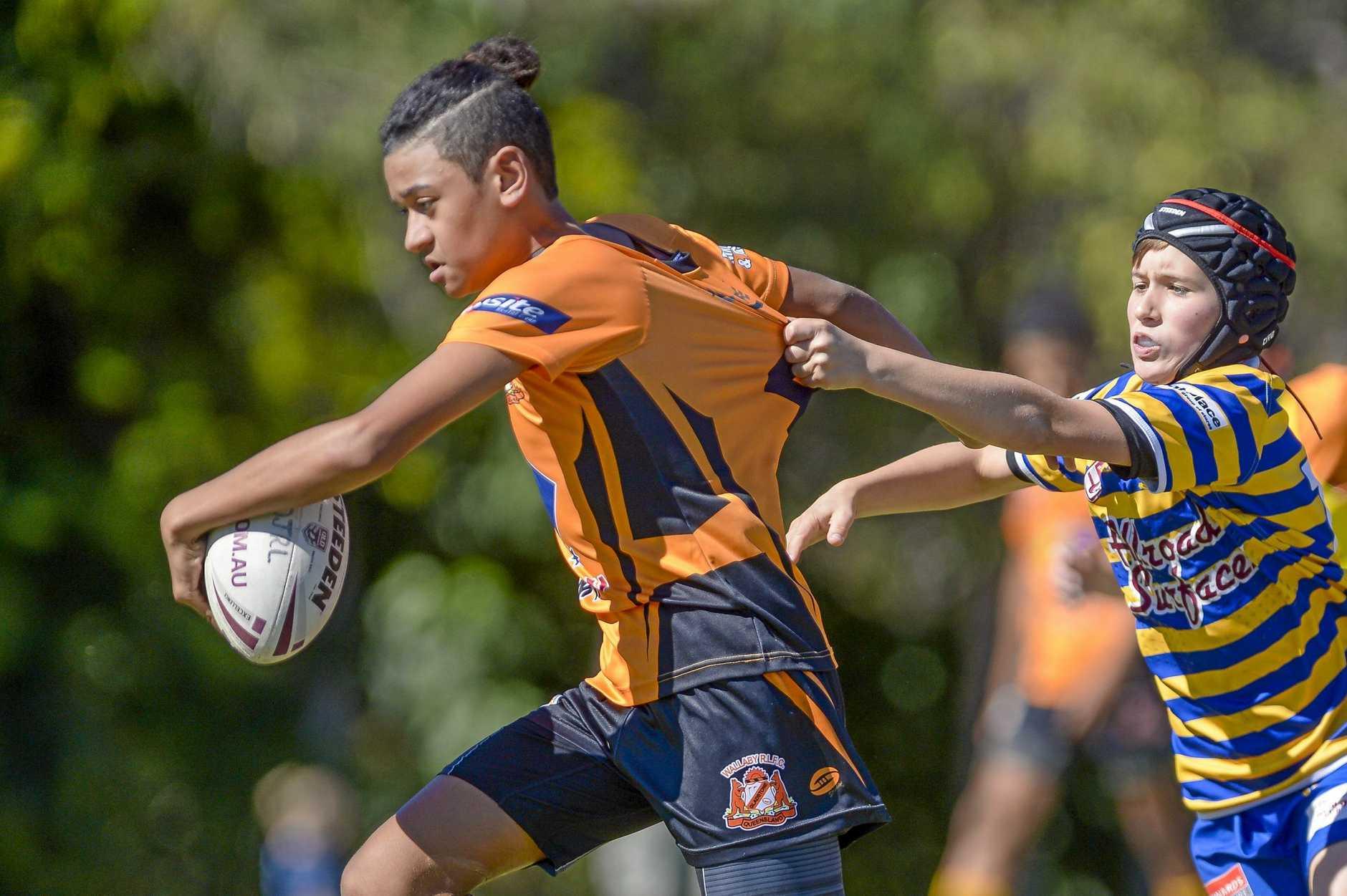 ONE STEP AHEAD: Gladstone Wallabys' Manasa Johnson-Saumalu shrugs off a tackle at the Jason Hetherington Cup.