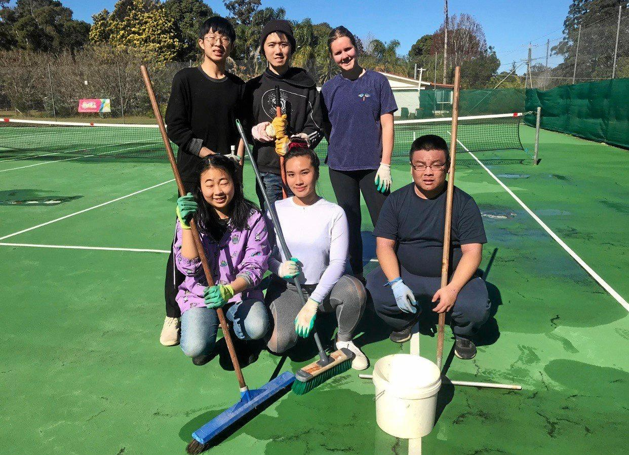 CLEANING COURTS: Annie Ell, Jessica Maie, Gavin Wong, Laurence Cai, Alice Perkes, and Justin Cai cleaning up the Blackbutt Tennis Courts.
