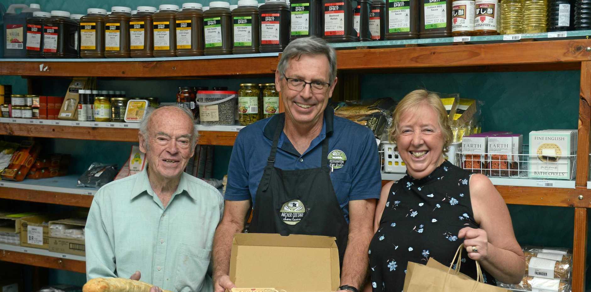 FROMMAGE FRIENDS: John Rasch of Adelaide, John Evans of Rockhampton Fine Foods and Susan Hagan say 'cheese' at Rockhampton Fine Foods.