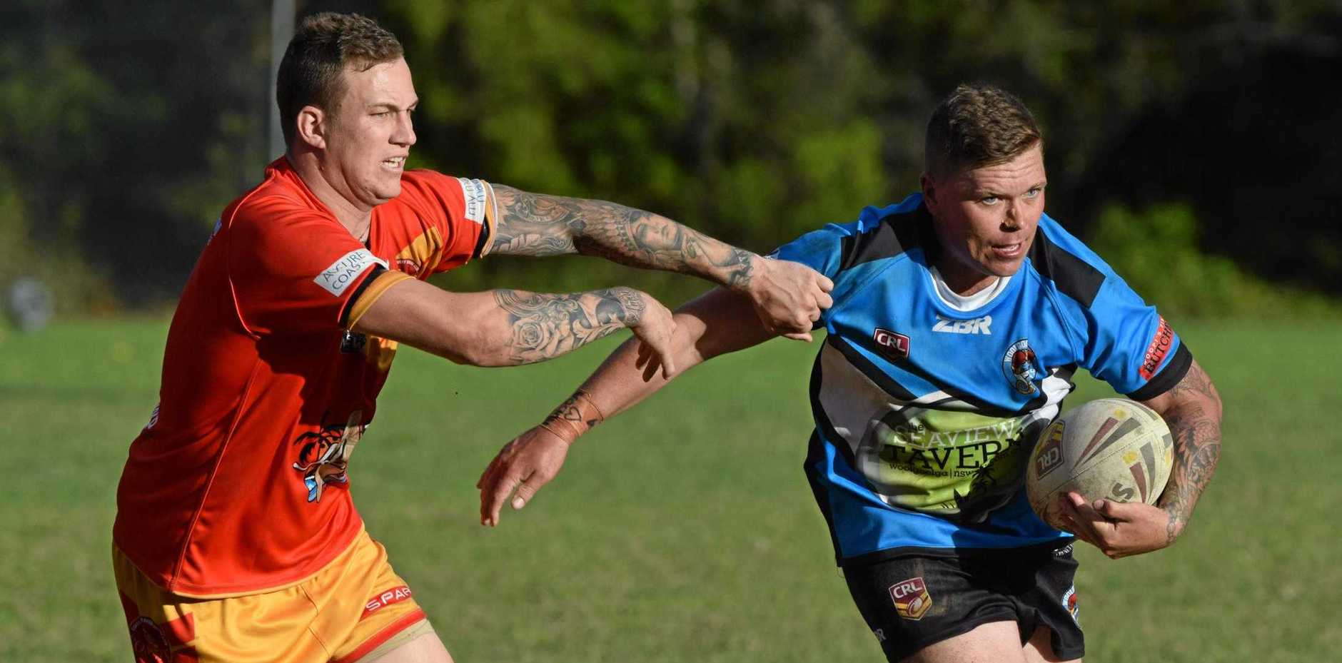 FIERCE RIVALS: Woolgoolga Seahorses hooker Michael Grant tries to get around Coffs Harbour Comets captain Brad Collinson when the two sides clashed in round six.