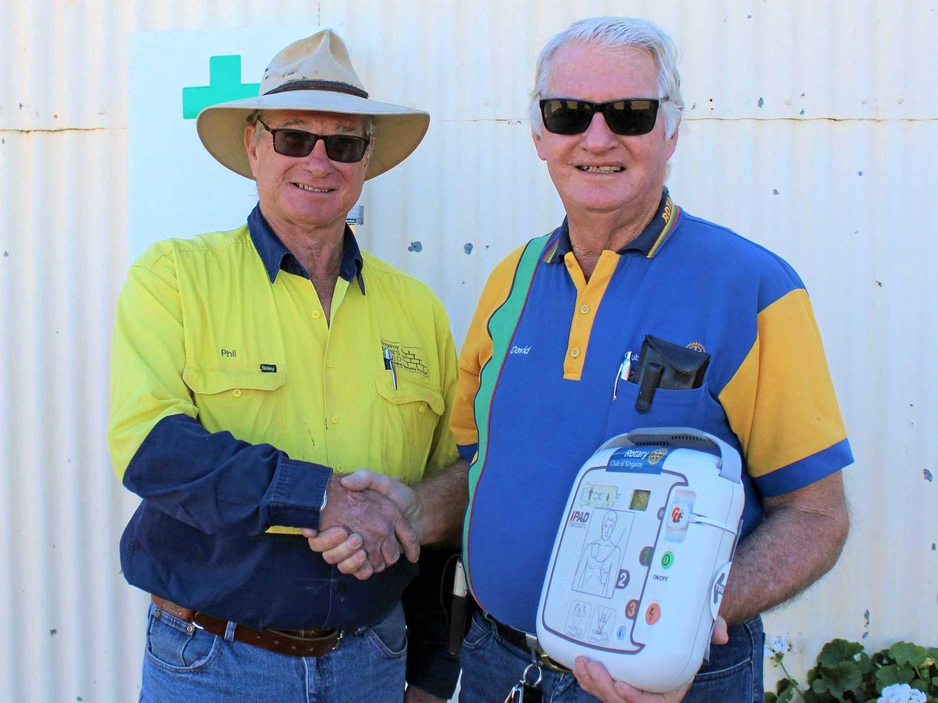 HANDOVER: Kingaroy Men's Shed president Phil Day receives the defibrillator from Kingaroy Rotary Club president David Black.
