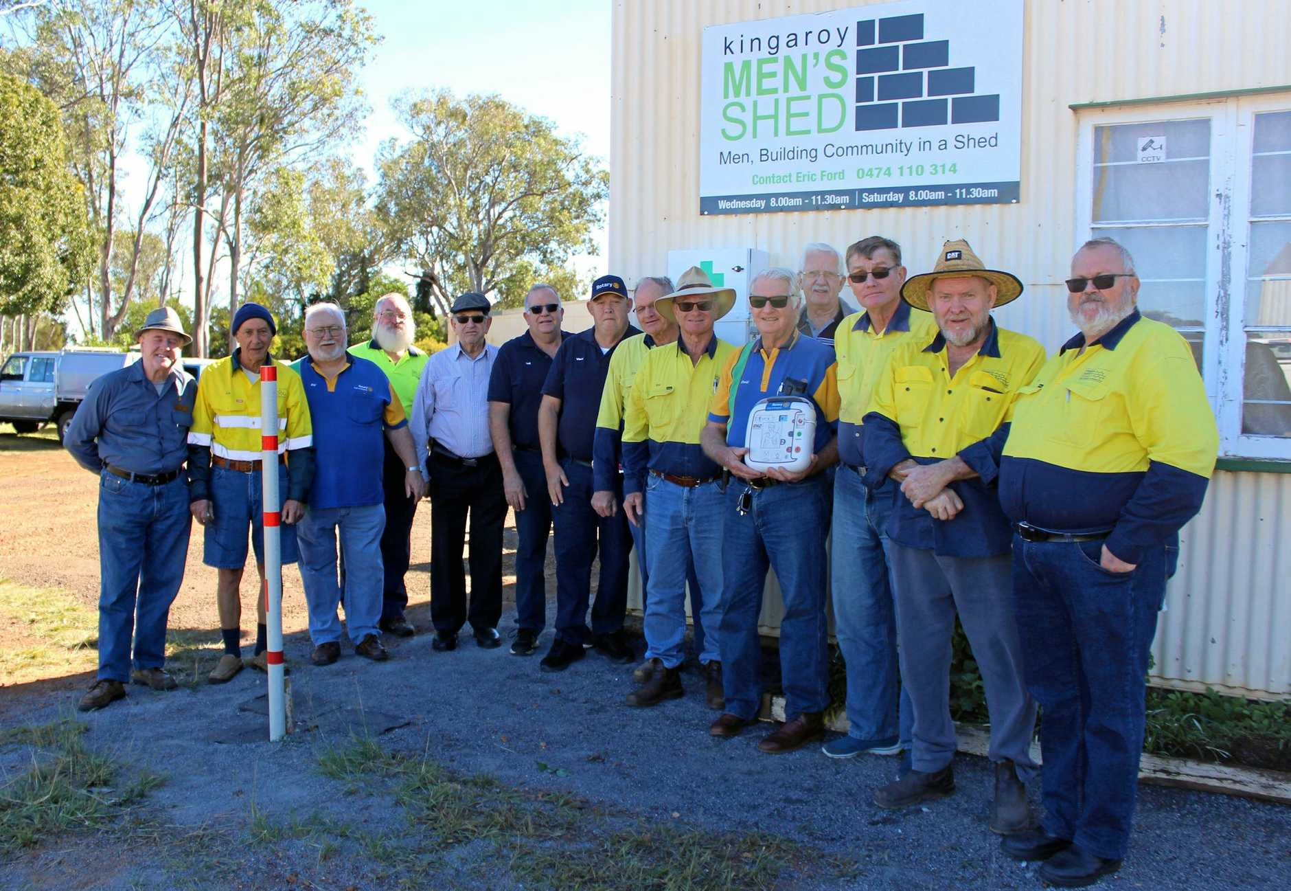 LIFE-SAVER: Members of the Kingaroy Rotary Club and Men's Shed gather to celebrate the instalment of the defibrillator.