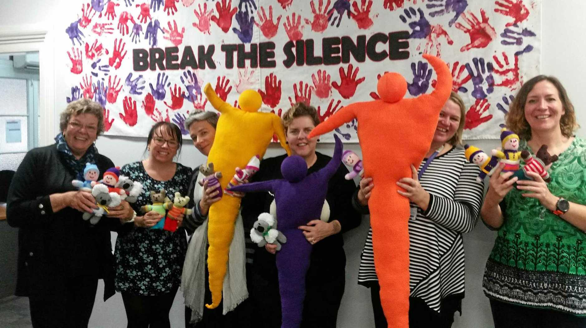 BREAK THE SILENCE: DVAC's team of volunteer knitters hope their tree jumper will encourage victims of domestic violence to seek support.