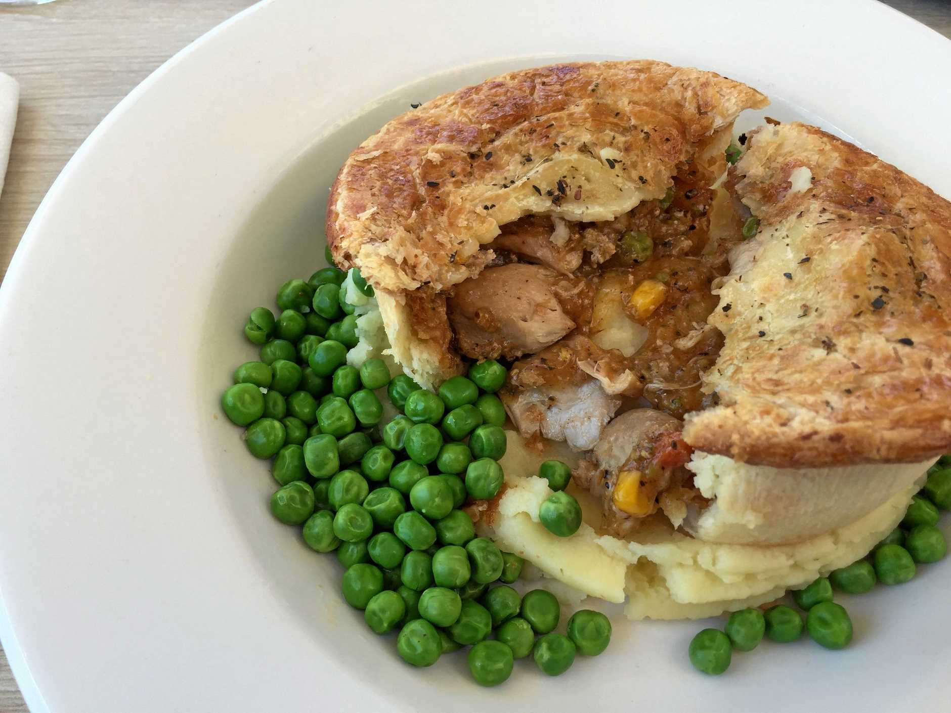The chicken peppercorn pie from the Reef Hotel, with fluffy mash and green peas.