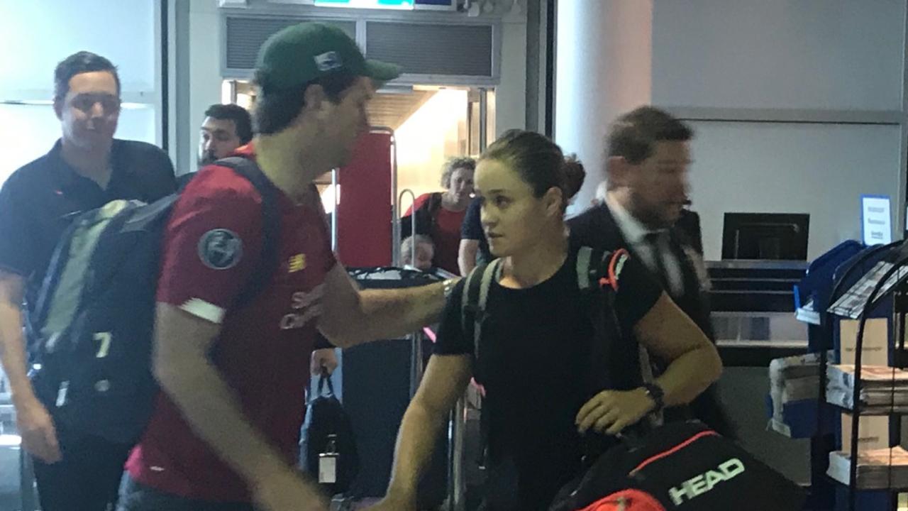 Ash Barty arrives back at Brisbane Airport